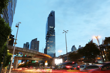 silom: View Silom road in twilight of Mahanakhon building,This is the new highest of building in Bangkok at Thailand.