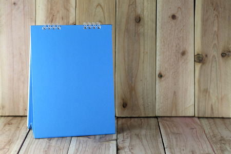 placed: Blue paper board placed on the old wooden floor.