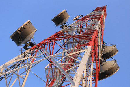 Antenna for Telephone communications in bright sky day time and have equipment connection tool of Wireless Internet business. Stock Photo