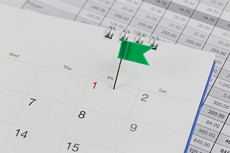 wildcats: Green Pins to Wildcats on the calendar beside the number red color of one in business concept time and date.
