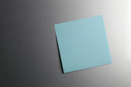 memorize: Empty blue paper sheet on refrigerator door for design and input text to concept food and drink etc.