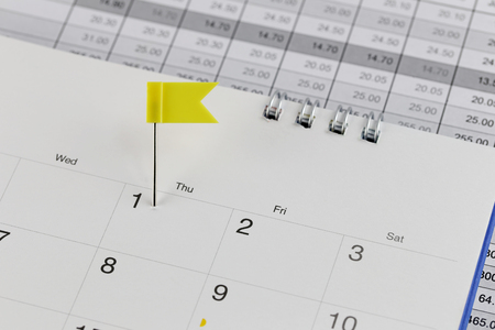 wildcats: Yellow Pins to Wildcats on the calendar beside the number of one in business concept time and date. Stock Photo