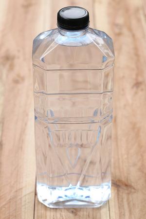 Plastic of Water bottles on wooden floor. Stock Photo