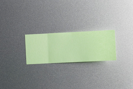 placed: Green of Note paper placed on refrigerator background,Design ideas can be Entered your Message into the space as needed.