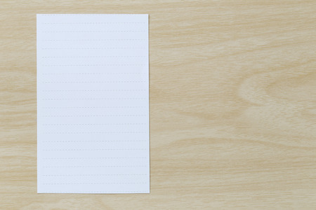 placed: Note paper placed on wooden floor,Design ideas can be Entered your Message into the space as needed. Stock Photo