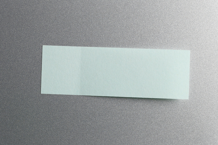 placed: Blue of Note paper placed on refrigerator background,Design ideas can be Entered your Message into the space as needed. Stock Photo