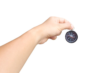 objects with clipping paths: hand of a man holding a compass on white background and have clipping paths to easy deployment.