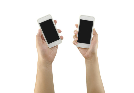 objects with clipping paths: White Smartphone in woman hand and man hand isolated on white background and have clipping paths to easy deployment.