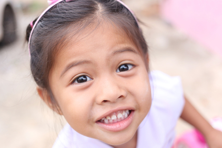 kiddy: Face of child girl Asian are smile happily,concept of mental health and lifestyle.