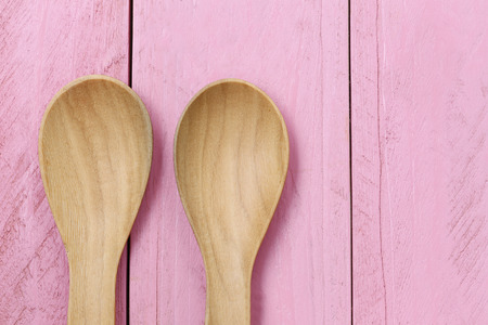 wooden floors: Wooden spoon on pink wood floors,concept of utensils and cooking.