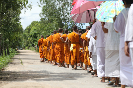 philanthropy: Monks were walking on the road for head to the temple,Religious ceremonies in the traditional Buddhist.