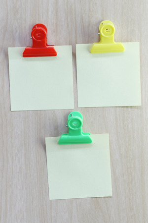 placed: Yellow of Note paper placed on wooden floor,Design ideas can be Entered your Message into the space as needed. Stock Photo