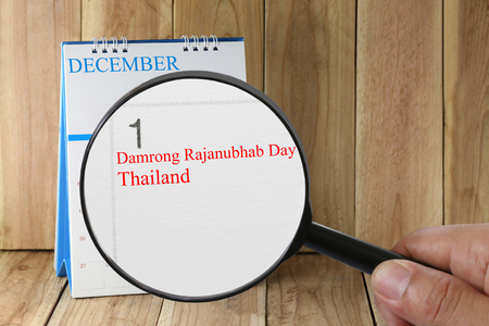 scheduling system: Magnifying glass in hand on calendar you can look text Damrong Rajanubhab Day in day 1 of Thailand to commemorate birthday of King Borom Department Damrong Rajanupab on 21 June 2405. Stock Photo