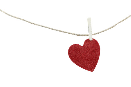 objects with clipping paths: Red heart shape hanging on a hemp rope isolated on white background and have clipping paths to easy deployment. Stock Photo
