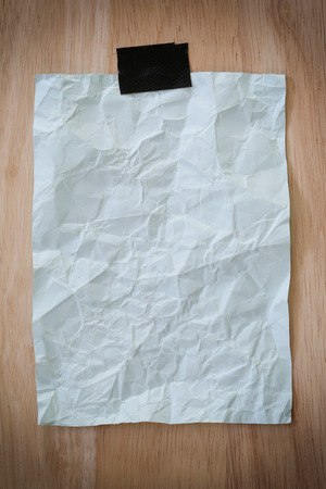 Blue notepad paper crumpled of empty and copy space on wooden background,You can input the message text in picture.