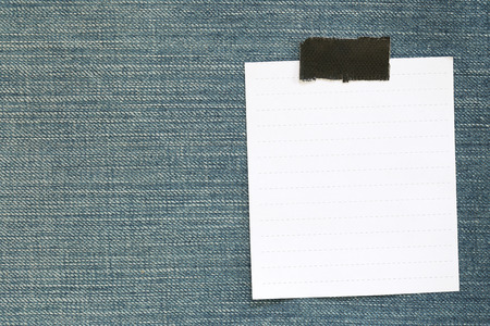 Note paper of empty and copy space on Denim background,You can input the message text in picture. Stock Photo