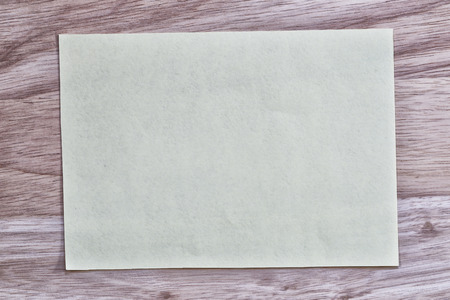 Yellow notepad paper of empty and copy space on wooden background,You can input the message text in picture.