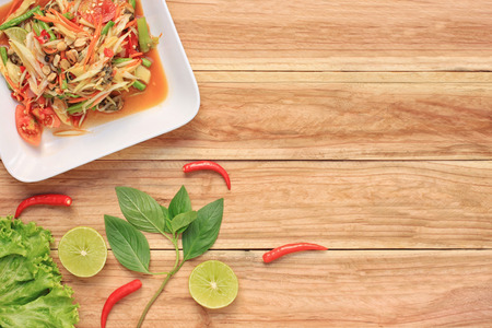 somtum: Top view Papaya salad of somtum in Thai food style for design diet background.