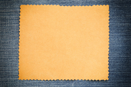 Brown cardboard of empty and copy space on Denim background,You can input the message text in picture.