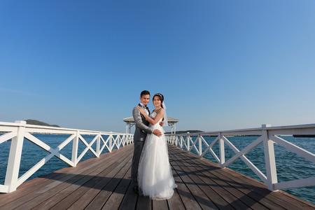 Pre Wedding photography thai couples on a wooden Atsadang bridge of Koh Si Chang Island at Thailand in concept love of memory. Stock Photo