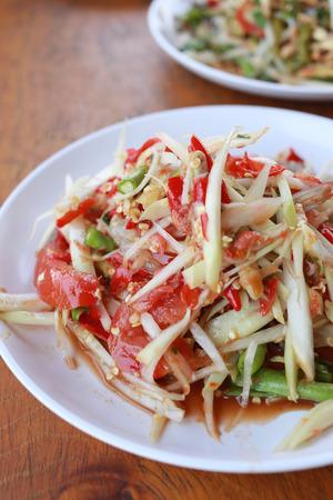 green papaya salad: Papaya salad or SOMTUM in Thai Foods,The food has been popular in Thailand.