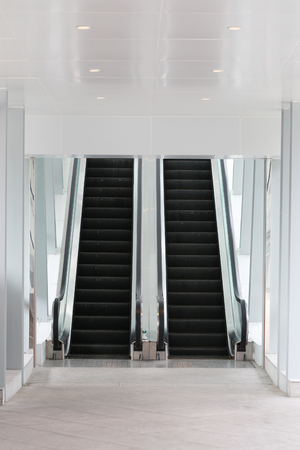 escalate: escalator in the mall and have path way to up and down.