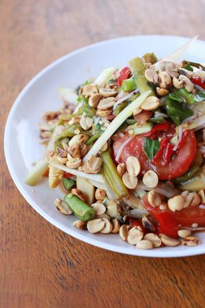 green papaya salad: Mix bean of Papaya salad or SOMTUM in Thai Foods,The food has been popular in Thailand.