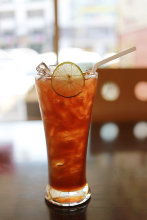 glass of iced lemon tea on foods table in a cafe.