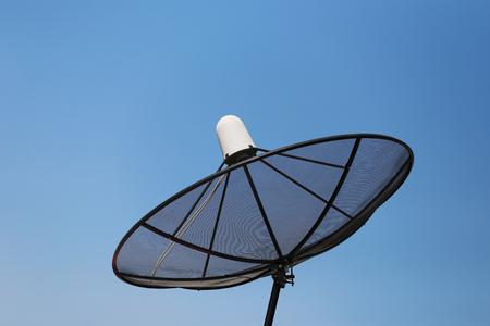 satelite: Black Satellite dish on blue sky background.