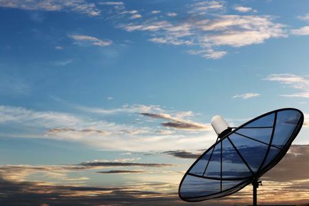 satelite: Black Satellite dish on twilight background.