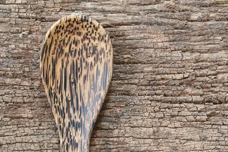 old items: Empty wooden spoon on wood floor in food design concept.