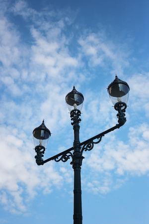 vintage of lamp post on blue sky background.