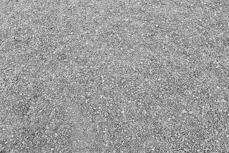 Surface of gray gravel road background for design backdrop in your work. Imagens