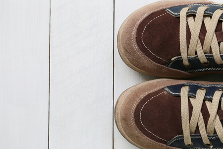white wood floor: Old sneakers on white wooden floor background and have copy space for design in your work.