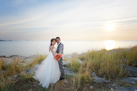 Asian love couples in pre wedding photography,Location Sichang Island Attractions in chonburi,Thailand.