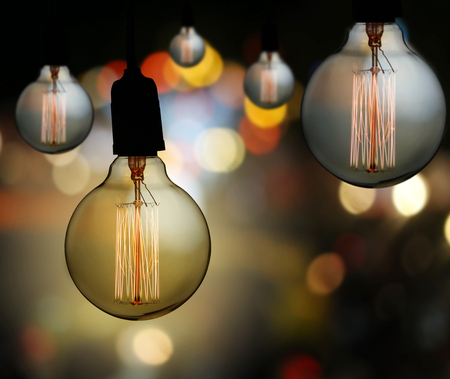 Vintage lamp or Modern Light bulb hang on ceiling in bokeh background,concept of interior and design in your work. Stock Photo