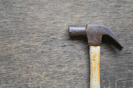 Old Hammer placed on a wooden floor and have copy space for design in your work.