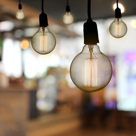 Vintage lamp or Modern Light bulb hang on ceiling in the restaurant,concept of interior and design in your work.