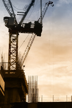 Area skyscraper of construction in evening time,silhouette picture for idea design in your work.