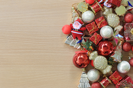 Equipment Christmas decorations are placed on a brown wooden floor and have copy space to input ideas of your work. Standard-Bild