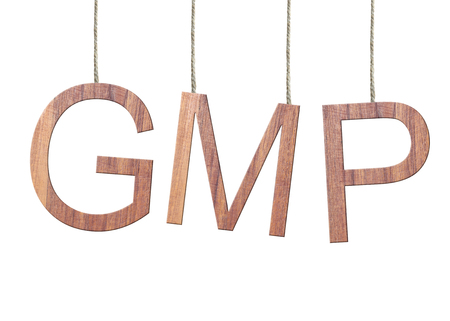 Wooden GMP text of Good Manufacturing Practice hanging on the ropes isolated on white background.