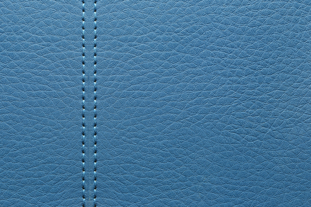 surface of the leather blue bag background for the design backdrop in your work.