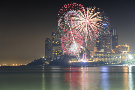 fireworks or firecrackers on night sky and hotels skyscraper of Pattaya,Popular tourist attractions in Thailand are many tourists want to travel. Stock Photo
