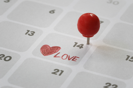 Red pin put on the calendar background in number fourteen concept of Valentines Day.
