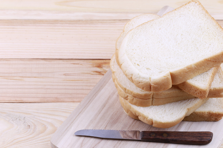 Sliced bread Stacked on a wooden chopping board and have copy space to design in your work.