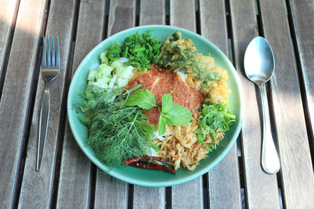 Thai Noodles (Kanom jeen) in a green dish on a food table.