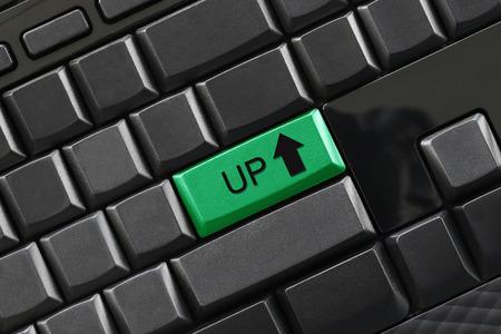 あなたのビジネスコンセプトのデザインのための黒のキーボードの入力ボタンにUPテキスト。 写真素材