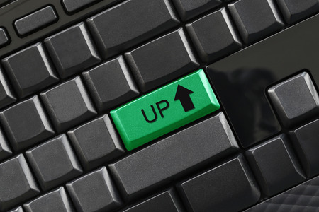 UP text on enter button of black keyboard for design in your business concept.