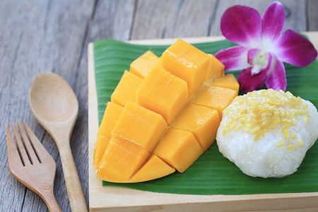 mango and sticky rice is popular traditional dessert of Thailand in photography of close-up style. Stock Photo