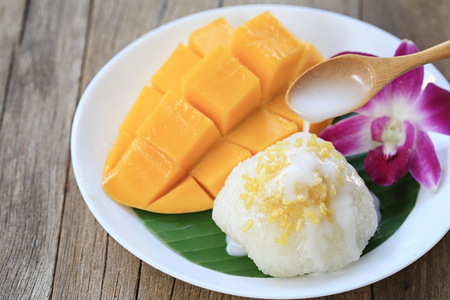 mango and sticky rice is popular traditional dessert of Thailand. Stock Photo